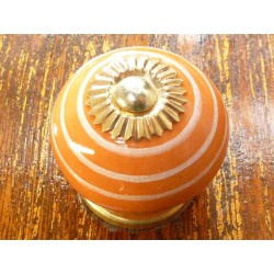 Porcelain knobs line white/orange