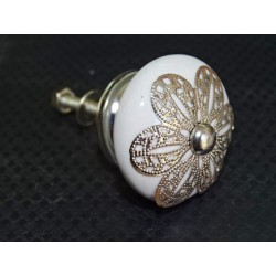 White porcelain handle with daisy metal ornament