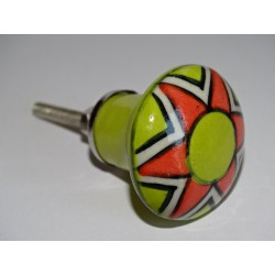 pastel green pear-shaped button and orange flower