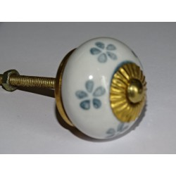 White drawer or door knobs and gray flowers